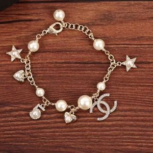 CHANEL Glass Pearl & Gold Crystal Charm Bracelet